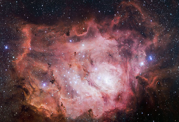 The Lagoon Nebula glows pink. Image released Jan. 22, 2014.