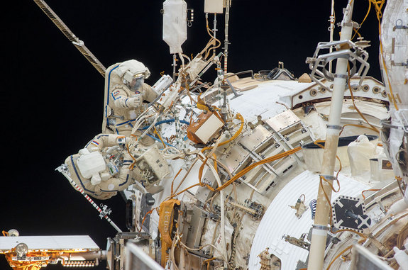 Cosmonauts Oleg Kotov and Sergey Ryazanskiy, as seen during their Dec. 27, 2013 spacewalk to install two UrtheCast cameras. The pair repeated the spacewalk Jan. 27, 2014 as a result of wiring and cabling issues with the cameras.