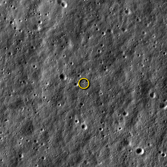 NASA's LADEE moon dust probe (circled) is photographed by the agency's powerful Lunar Reconnaissance Orbiter in this image released on Jan. 29, 2014. The image, taken on Jan. 14, shows LADEE from a distance of 5.6 miles (9 kilometers) away as the two spacecraft passed each other as they orbited the moon. Both spacecraft are orbiting the moon with velocities near 3,600 mph (1,600 meters per second), so timing and pointing of LRO must be nearly perfect to capture LADEE in an LROC image.