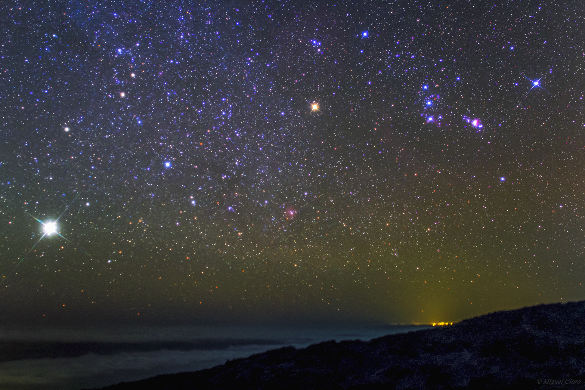 Jupiter and Orion Shine Over Canary Islands in Dazzling Night Sky Photo