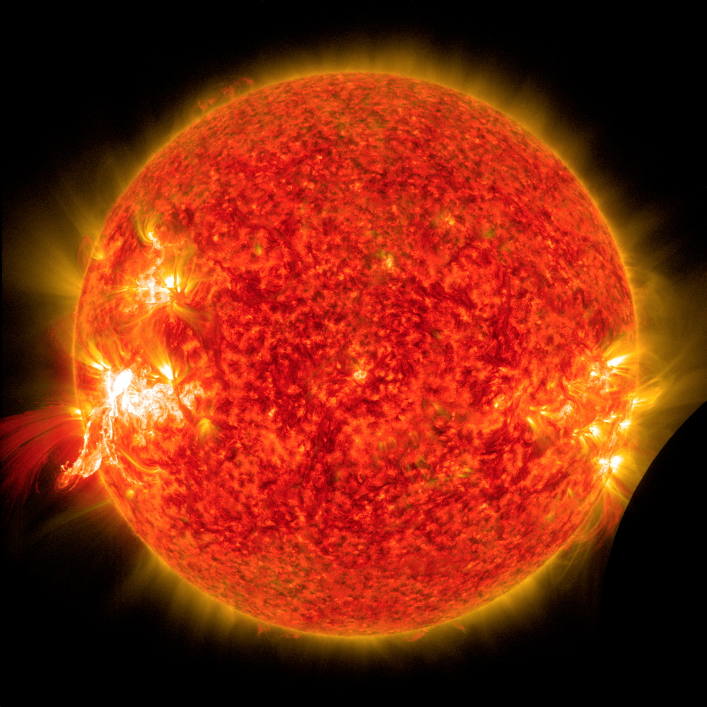 NASA's Solar Dynamics Observatory Sees a Solar Flare and a Lunar Transit