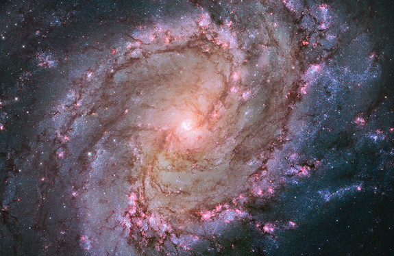 This Hubble Space Telescope image shows the full beauty of nearby spiral galaxy M83 in a mosaic of many photos stitched together. The magentas and blues indicate star-forming regions. Also known as the Southern Pinwheel, M83 is located 15 million light-years away in the constellation Hydra. Image released January 2014.