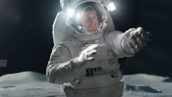 NFL star Tim Tebow wears a spacesuit on the moon in this still from T-mobile's Super Bowl XLVIII ad.