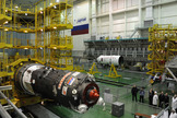 Engineers prepare the unmanned Progress 54 cargo ship for a Feb. 5, 2014 launch to the International Space Station. The spacecraft will launch atop a Soyuz rocket from Baikonur Cosmodrome in Kazakhstan.