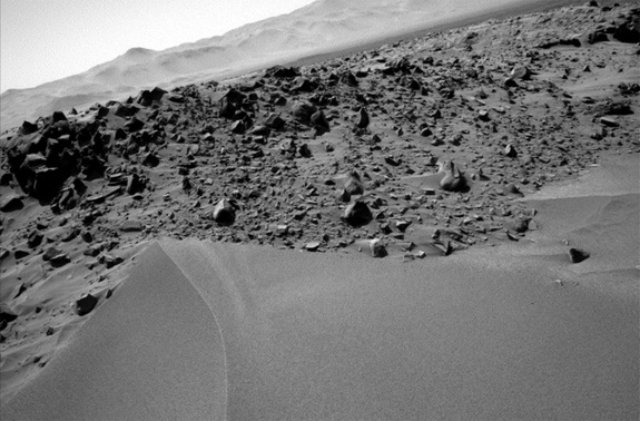 During ascent, Curiosity snapped this shot of the surrounding terrain, a view that demonstrates the upward slope of the dune.