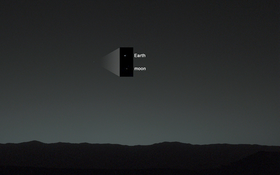NASA's Mars rover Curiosity took this photo of Earth from the surface of Mars on Jan. 31, 2014, 40 minutes after local sunset, using the left-eye camera on its mast. The inset shows a zoomed-in view of the Earth and moon in the image.