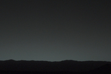 This view of the twilight sky and Martian horizon taken by NASA's Curiosity Mars rover includes Earth as the brightest point of light in the night sky. Earth is a little left of center in the image, and our moon is just below Earth. The Curiosity rover snapped the photo on Jan. 31, 2014.