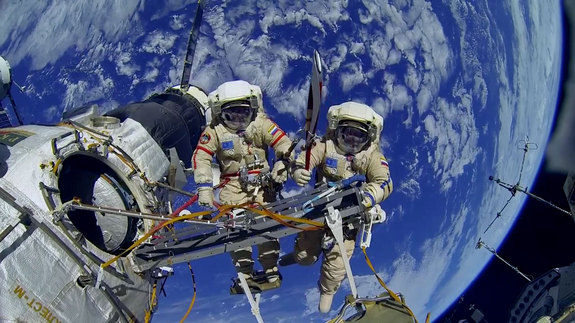 Cosmonauts Oleg Kotov and Sergey Ryazanskiy are seen posing with the Olympic torch during a Nov. 9, 2013 spacewalk outside the International Space Station. The same torch was used to light the Olympic Cauldron in Sochi, Russia.
