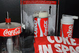 Coke in space: Coca-Cola in space memorabilia, including one of the original 1985 space Coke cans (center).
