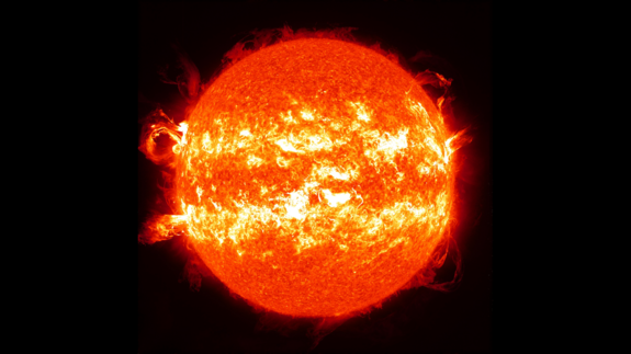 This image is a composite of 25 separate images spanning the period of Feb. 11, 2013 to Feb. 11, 2014. It uses the SDO AIA wavelength of 304 Angstroms and reveals the zones on the sun where active regions and associated eruptions most commonly occur during Solar Maximum.