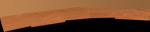 "The boulder-studded ridge in this scene recorded by NASA's Mars Exploration Rover Opportunity is ""McClure-Beverlin Escarpment."" This view toward the south is a mosaic of images taken by Opportunity's panoramic camera (Pancam) on Dec. 25, 2013."
