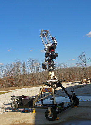 "Waiting for ""first light"" with a home-built 108mm refractor on a home-built astronomy cart. The cart has a built-in 12-Volt source, a scanner radio for NOAA weather, leveling jacks and a custom shelf for a DVD burner I use when making videos of the sky."