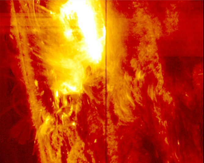 A solar flare erupts