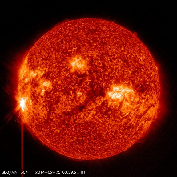 A massive X4.9 solar flare erupts from a long-lived sunspot on the sun at 00:49 GMT on Tuesday, Feb. 25 (7:49 p.m. Monday, Feb. 24 EST) in this view from one of many light wavelength observations by NASA's Solar Dynamics Observatory.