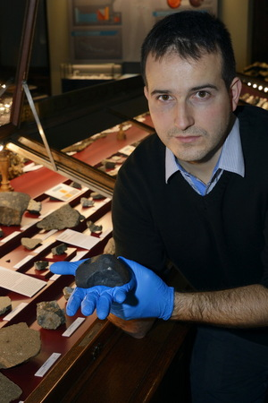 Meteorite scientist Ludovic Ferrière holds a chunk of Chelyabinsk skyfall at the Natural History Museum in Vienna.