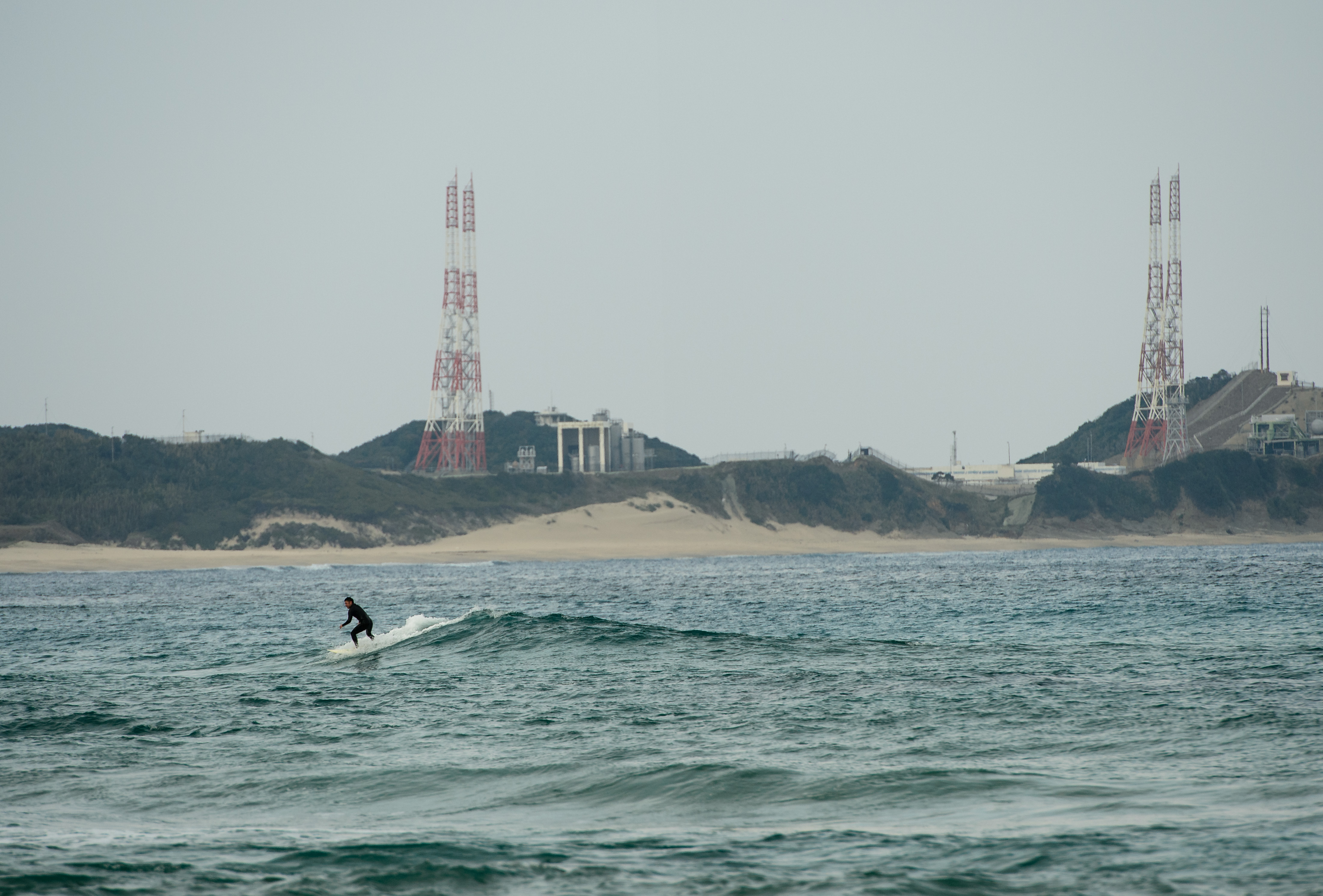 Surfer Catches Wave Near Tanegashima Space Center