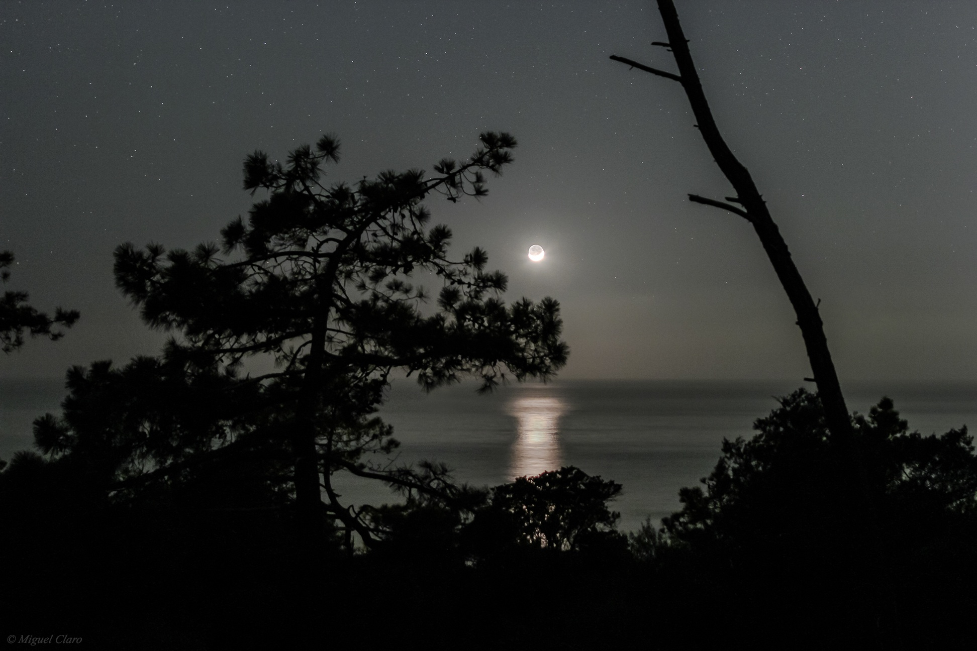 Moonset Off Portuguese Coast by Miguel Claro