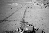 NASA's Curiosity Mars rover used the Navigation Camera (Navcam) on its mast for this look back after finishing a drive of 328 feet (100 meters) on the 548th Martian day, or sol, of the rover's work on Mars (Feb. 19, 2014).