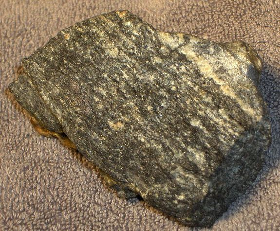 A fist-size sample of the Acasta Gneisses, rocks in northwest Canada that are the oldest known rocks on Earth.
