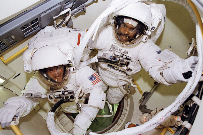 Space History Photo: Bernard Harris and Michael Foale Prepare to Leave Airlock