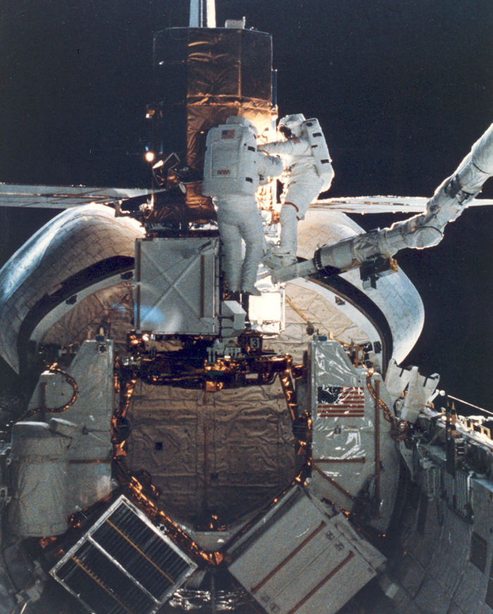 Space History Photo: STS-41C Astronauts Repair the SMMS