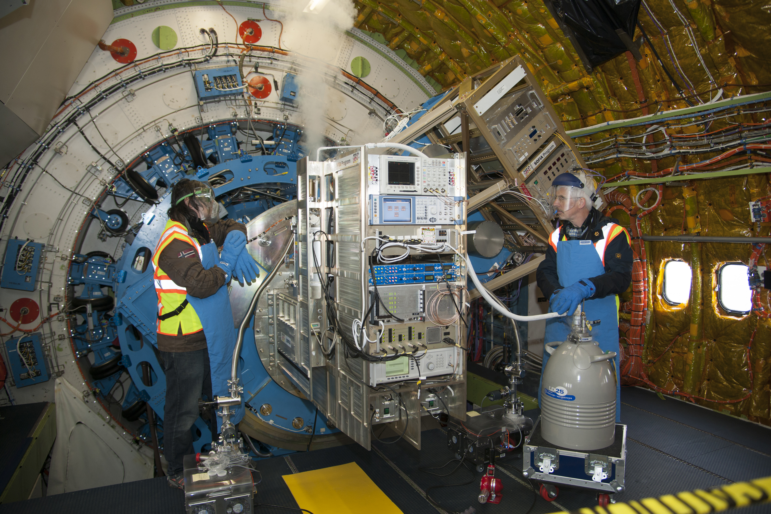SOFIA: Cooling the GREAT Spectrometer