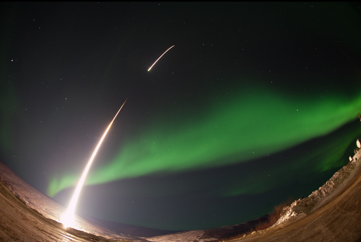 NASA Rocket Streaks Through Aurora 'Curls' in Stunning Launch Photos