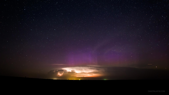"This image is a still showing an aurora behind a building thunderstorm from the time-lapse film ""Huelux,"" shot from April to November 2013, in South Dakota, Wyoming and Utah by astrophotographer Randy Halverson."
