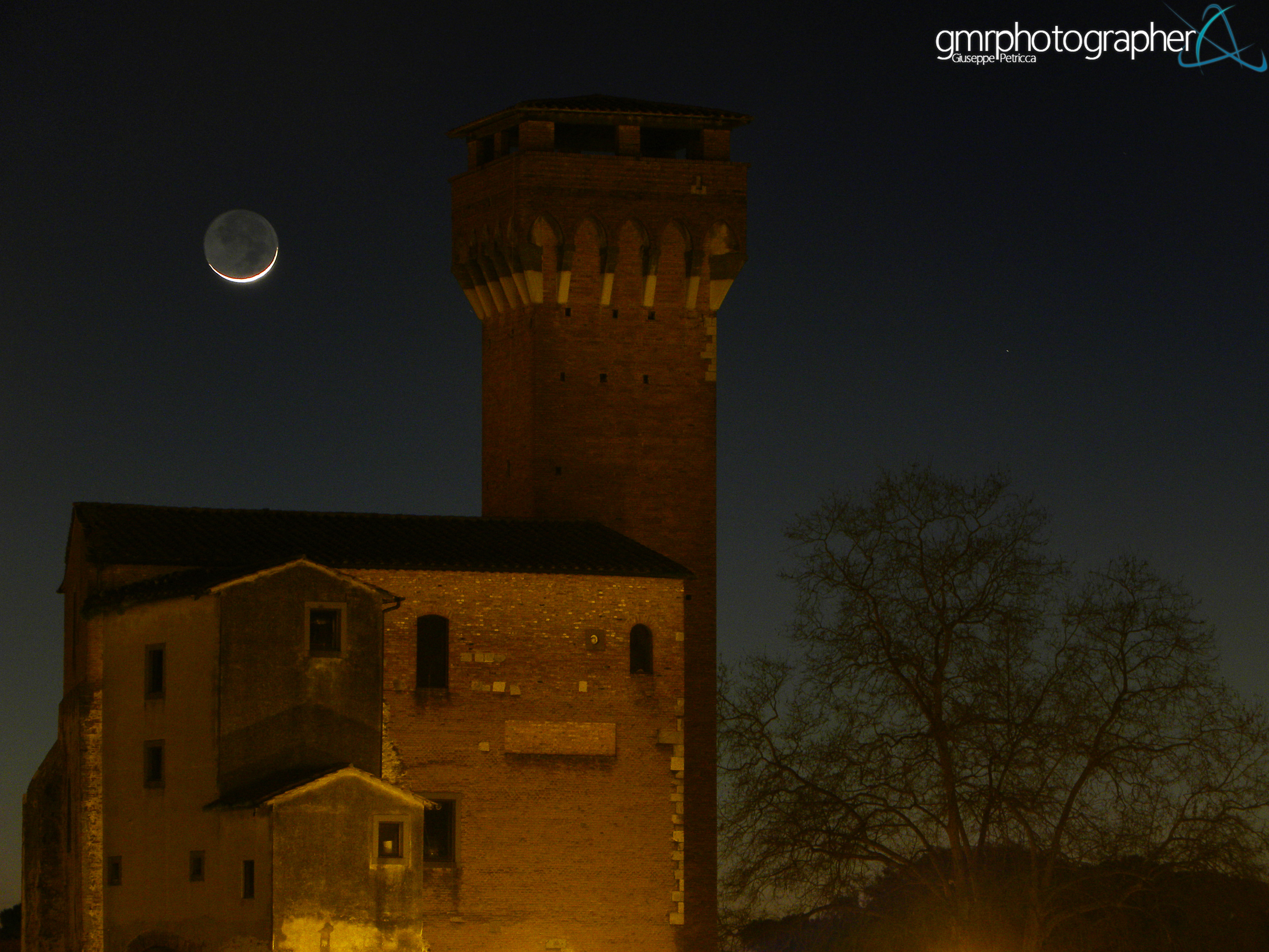 Moon Aglow with Earthshine Over Citadel by Giuseppe Petricca