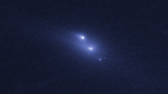 This photo from the Hubble Space Telescope shows the rare sight of the asteroid P/2013 R3 breaking apart. This image, the first in a series, was taken on Oct. 29, 2013.