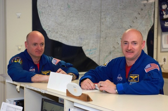 Astronauts Mark Kelly (right) and Scott Kelly are pictured in the check-out facility at Ellington Field near NASA's Johnson Space Center.