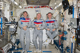 Expedition 38 crewmembers (from left) Mike Hopkins, Oleg Kotov and Sergey Ryazanskiy gather inside the International Space Station's Kibo laboratory for a crew portrait ahead of a planned March 10, 2014 landing aboard their Soyuz TMA-10 spacecraft