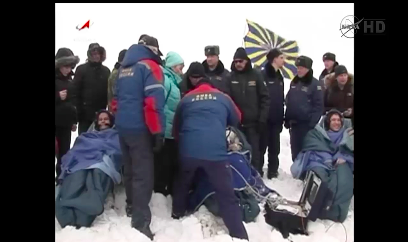 Soyuz Spacecraft Returns US-Russian Space Station Crew to Earth Amid Wind, Snow