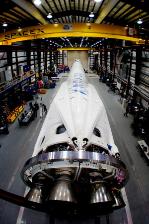 SpaceX Falcon 9 v1.1 rocket, equipped with landing legs, awaits launch in the private spaceflight company's hangar at Cape Canaveral, Fla. Image added March 11, 2014.