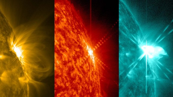 A solar flare erupts from the sun on March 12, 2014. NASA's Solar Dynamics Observatory captured it in several wavelengths of light, shown here in different colors.