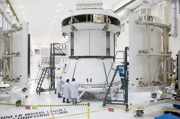NASA engineers ready the Orion EFT-1 mock service module for installation of the fairings that will protect it during launch when Orion lifts off on its first mission, now slated for December 2014.