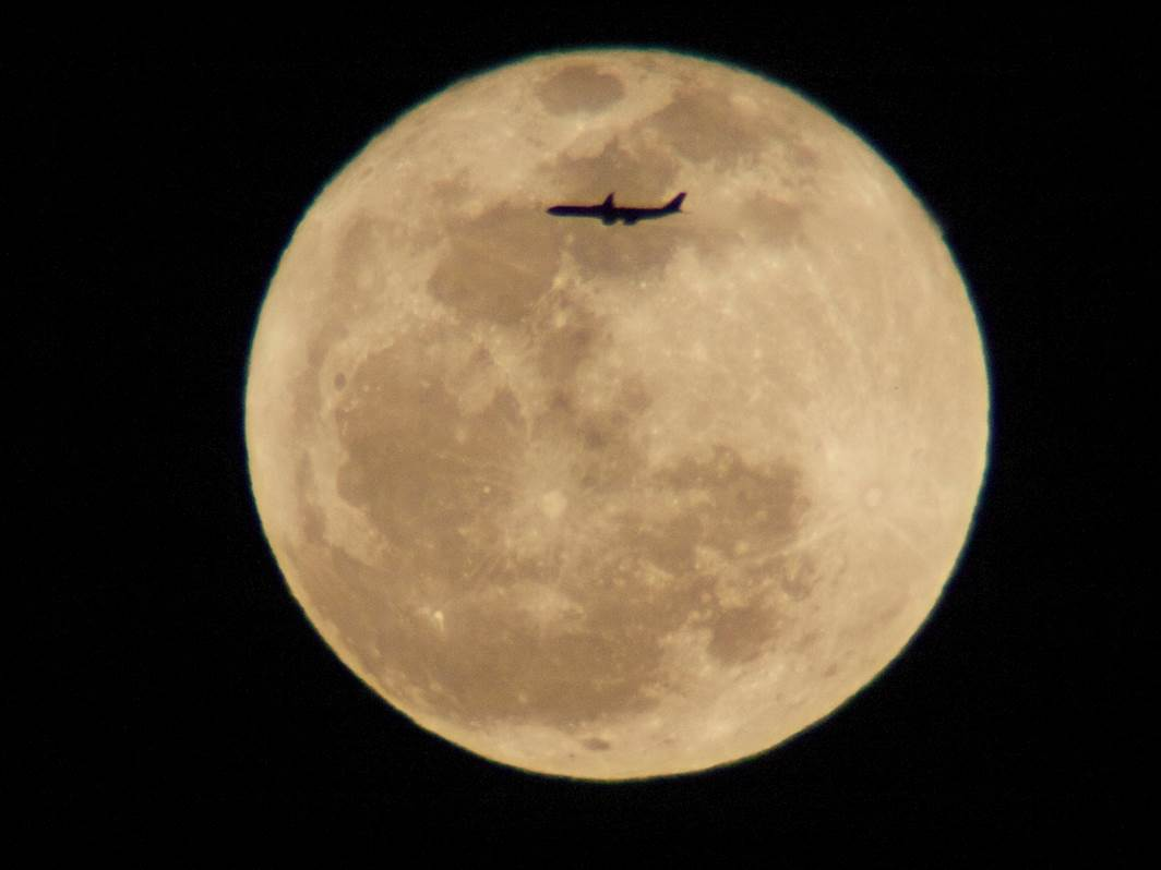 Airplane and Full 'Worm' Moon Over L.A