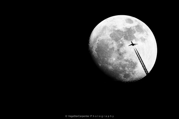"Night sky photographer VegaStar Carpentier captured this image of an airplane cruising across a 92 percent full moon over France on March 13, 2014. ""A rare and precious moment,"" Carpentier wrote Space.com in an email."