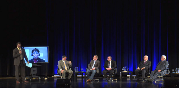 Astrophysicist Neil deGrasse Tyson (far left) hosts the 2014 Asimov Memorial Debate, focused on selling private spaceflight, on March 19, 2014 at the American Museum of Natural History in New York City, NY.