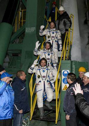Expedition 39 Soyuz Commander Alexander Skvortsov of the Russian Federal Space Agency, Roscosmos, bottom, Flight Engineer Steve Swanson of NASA, middle, and Flight Engineer Oleg Artemyev of Roscosmos, wave farewell prior to boarding the Soyuz TMA-12M rocket for launch, Wednesday, March 26, 2014 local time (March 25 EDT) at the Baikonur Cosmodrome in Kazakhstan.