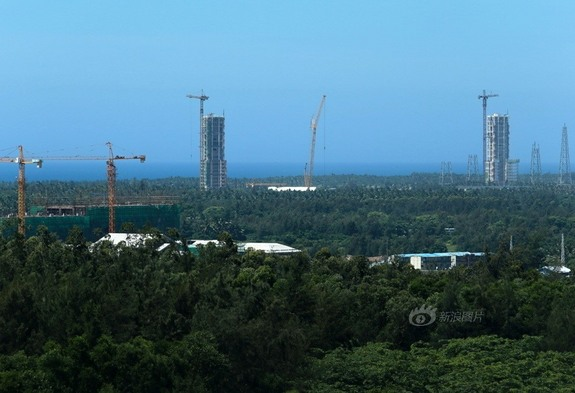 Work on China's newest spaceport on Hainan Island is in full swing with rocket assembly towers stretching into the sky.