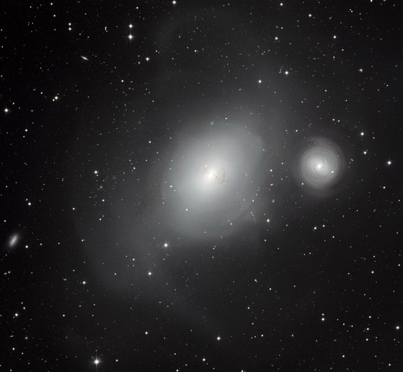 This new image from the MPG/ESO 2.2-metre telescope at ESO's La Silla Observatory in Chile shows a contrasting pair of galaxies: NGC 1316, and its smaller companion NGC 1317 (right).