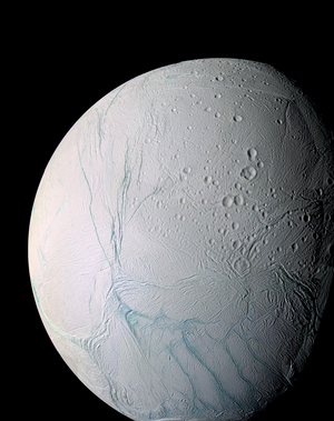 "Image of Saturn's moon Enceladus, showing the ""tiger stripes,"" long fractures from which the water vapor jets are emitted."