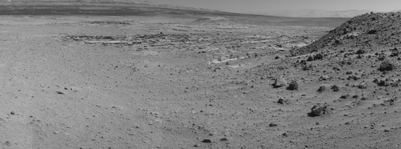 "This view from NASA's Curiosity Mars rover was taken the day before the rover's final approach drive to ""the Kimberley"" waypoint, selected months ago as the location for the mission's next major investigations. It combines several frames taken by the Navigation Camera on April 1, 2014."
