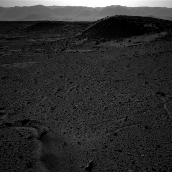 This image — captured by the left-side navigation camera on NASA's Mars Curiosity rover on April 3, 2014 — shows the same Martian locale where a bright flash seemed to appear that day in an image taken by the righthand navcam. Though the two navcam photos were taken at about the same time, no flash is visible in this one.