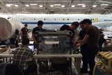 The team gets ready to load their experiment into a ZERO-G plane.