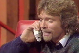 "Sir Richard Branson speaks with the child Shihan Musafer by phone on BBC TV's ""Going Live!"" show in 1988. Branson credits Musafer for inspiring him to found Virgin Galactic and now, 25 years later, hopes to reconnect."