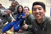 From left: Student Victor Hong, NASA astronaut Nicole Stott, Andrew Beeler and Henry Lu pose for a selfie aboard a their zero-gravity flight on April 10, 2014. The University of California, San Diego students were testing how biofuels burn in weightless conditions.