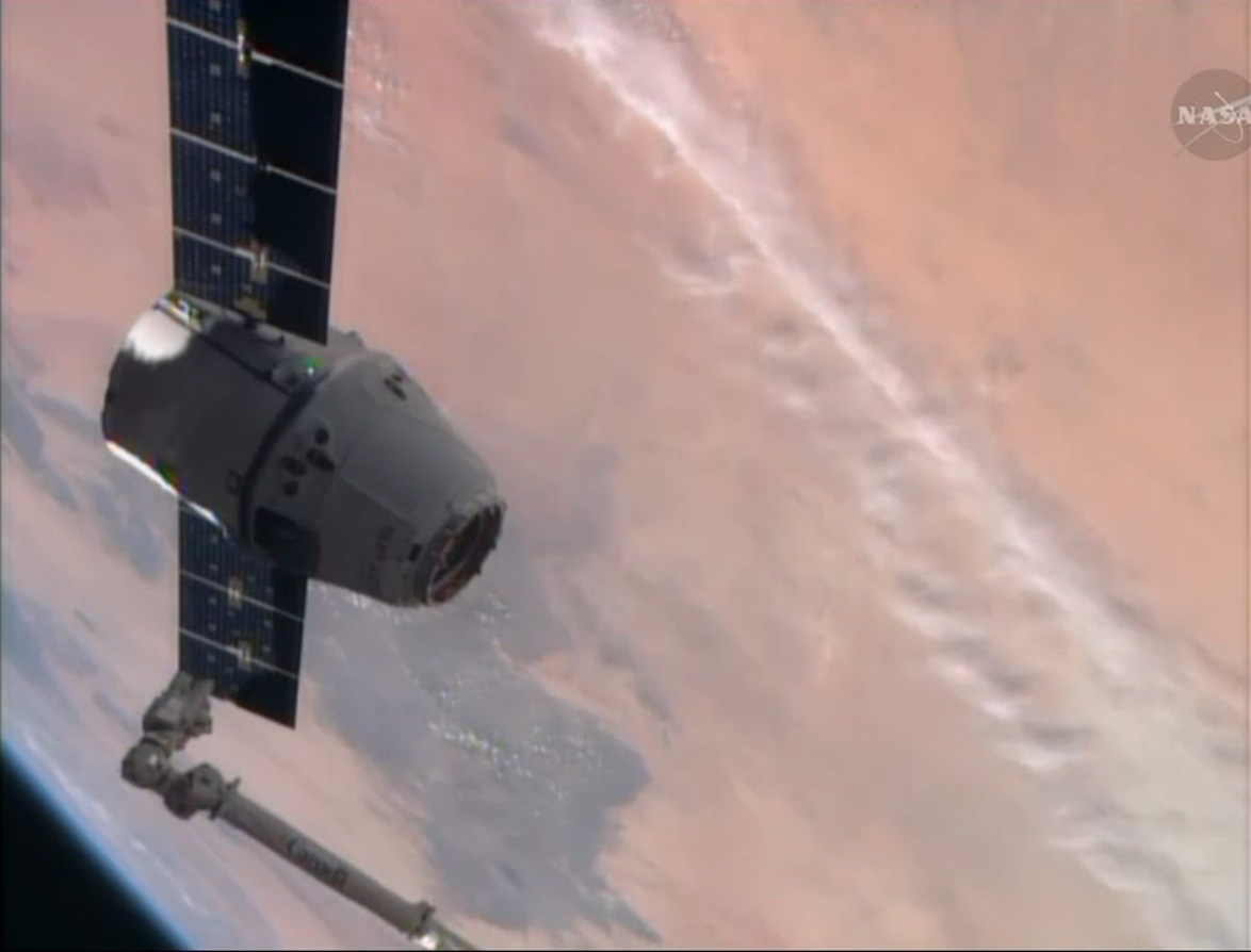 SpaceX Dragon Cargo Ship and Earth