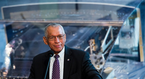 "NASA Administrator Charles Bolden, who was the pilot of the space shuttle mission that launched the Hubble Space Telescope on April 24, 1990, is seen backdropped by the WFPC2 instrument at the debut of the ""Repairing Hubble"" exhibit at the National Air and Space Museum in Washington, D.C. on April 23, 20"